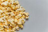 picture of popcorn  - Full popcorn in classic popcorn box on grey background - JPG