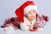 stock photo of christmas baby  - Beautiful little baby celebrates Christmas - JPG
