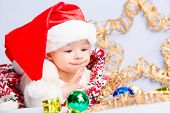 stock photo of christmas baby  - Beautiful little baby celebrates Christmas. New Year