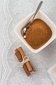 foto of pasteis  - Cinnamon sticks and powder on ceramic bowl - JPG