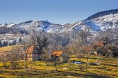 foto of hamlet  - Countryside landscape with traditional Romanian mountainous hamlet and snow covered hills in Moeciu Brasov county Trasylvania region Romania - JPG