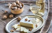 pic of brie cheese  - Brie Cheese With Walnuts On The Wooden Table - JPG
