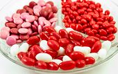 stock photo of jelly beans  - Assorted Valentine candies of red and white jelly beans - JPG