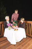 image of clientele  - older couple in outdoor restaurant at night  - JPG