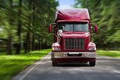 stock photo of truck-cabin  - Used truck on the forest track blurred motion - JPG