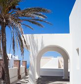 image of greek-architecture  - Traditional Greek architecture with white arch on blue sky - JPG