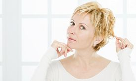 stock photo of birthmark  - Forty years woman with short blonde hair - JPG