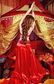 stock photo of belly-dance  - Sexy oriental beauty dancing belly dance in front of the tent - JPG