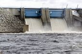 foto of dam  - Open floodgates on a dam in a river from the North of Sweden - JPG