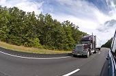 foto of semi trailer  - Fisheye lens used to shoot this shot of someone passing a semi - JPG