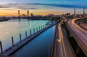 stock photo of portland oregon  - Portland Oregon view of the Steel Bridge with light reflections on the Willamette River - JPG