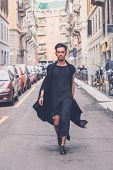 picture of tunic  - Young handsome Asian model dressed in black tunic posing in the city streets - JPG