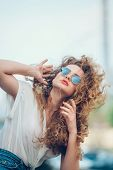 picture of hair blowing  - Beauty Girl Outdoors enjoying nature - JPG
