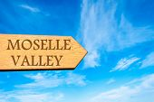 picture of moselle  - Wooden arrow sign pointing destination MOSELLE VALLEY LUXEMBOURG against clear blue sky with copy space available - JPG