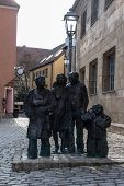 picture of holy-spirit  - Statue showing a familiy standing close to the Church of the Holy Spirit in German referred as the Stadtkirche Heilig Dreifaltigkeit which is located in the historic area of the city of Bayreuth - JPG