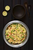 picture of sweet-corn  - Vegetarian couscous salad made with bell pepper tomato cucumber red onion and sweet corn kernels served in salad bowl with rustic bowls wooden spoons and lemon on the side - JPG