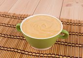 stock photo of peas  - Pea soup in a green bowl - JPG