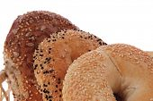 stock photo of bagel  - three different bagels in basket isolated over white background - JPG