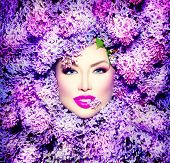 stock photo of violet flower  - Beauty fashion model Girl with Lilac Flowers Hair Style - JPG