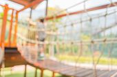 stock photo of public housing  - Defocused and blur image of young boy try to cross the bridge in children - JPG