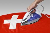 stock photo of iron star  - Steam iron for smooth out the wrinkles of Flag from Switzerland - JPG