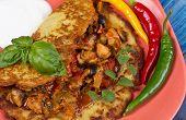 stock photo of hungarian  - Hungarian style potato pancake filled with stew - JPG