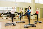 picture of step aerobics  - Group of women making step aerobics in the fitness class