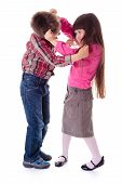 stock photo of pulling hair  - Fighting children little boy and girl pulling each other hair - JPG