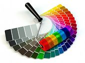 foto of color wheel  - Roller brush and color guide palette in rainbow colors - JPG