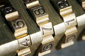 stock photo of combinations  - macro shot of golden padlock combination numbers - JPG