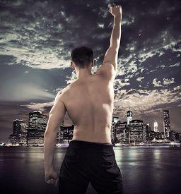 pic of strongman  - Triumphant athletic strongman - JPG