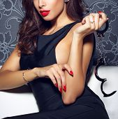Постер, плакат: Sexy Sensual Woman With Red Lips Holding Handcuffs