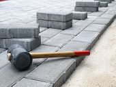 stock photo of bricklayer  - Pavement under construction.