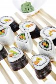 Постер, плакат: Maki Rolls and California rolls made of fresh raw Salmon Tuna and Eel with Cream Cheese and Avocado