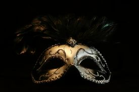 picture of masquerade mask  - a black and silver mask isolated on a black background - JPG