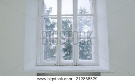 poster of Blank white wall with window. Slide motion of movement or hitting the camera on empty light white room with window. Construction Home Empty room interior window aluminum on wall