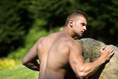 Sportsman Man With Strong Hands Biceps, Triceps Push Boulder poster