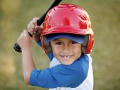 image of game_over  - Young hispanic or latino boy with red baseball helmet over a blue hat and ble tee shirt - JPG