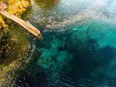 Aerial view of the karst lake named Goluboye Ozero (Blue Lake). Maximum depth is 18m (60ft). Lake is poster