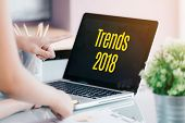 Trends 2018 On Laptop Screen With Business People Meeting In Front Of Computer Screen On Desk At Off poster
