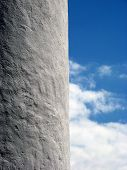 pic of arsenic  - White Wall and Blue Sky with White Clouds - JPG