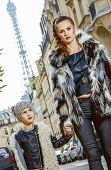 Mother And Child Nearby Eiffel Tower In Paris, France Walking poster