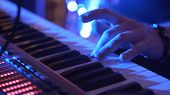 Closeup Of Male Hands Playing Piano. Man Playing The Synthesizer Keyboard. Man Plays Music Keyboard. poster