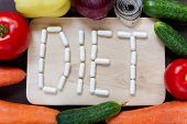 Fresh Organic Vegetables With Measuring Tape And Word Diet Made Of Pills On Wooden Board Background, poster
