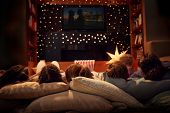 Family Enjoying Movie Night At Home Together poster
