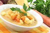 stock photo of rutabaga  - fresh boiled rutabaga soup with beef carrots potatoes and parsley - JPG