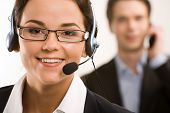 stock photo of telephone operator  - Portrait of responsible operator on the background of businessman - JPG