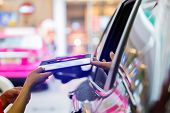 Selective Focus To Passenger Woman Pay Credit Card With Staff For Fuel In Gas Station. poster