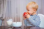 Healthy Food. Boy Cute Baby Eating Breakfast. Baby Nutrition. Eat Healthy. Toddler Having Snack. Hea poster