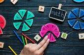 Kids Hand Moves Colorful Math Fractions On Dark Wooden Background Or Table. Interesting Creative Fun poster